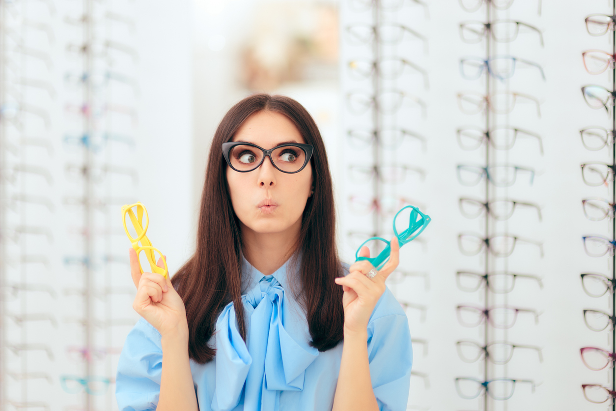 Girl Choosing Eyeglasses Frames in Optical Store