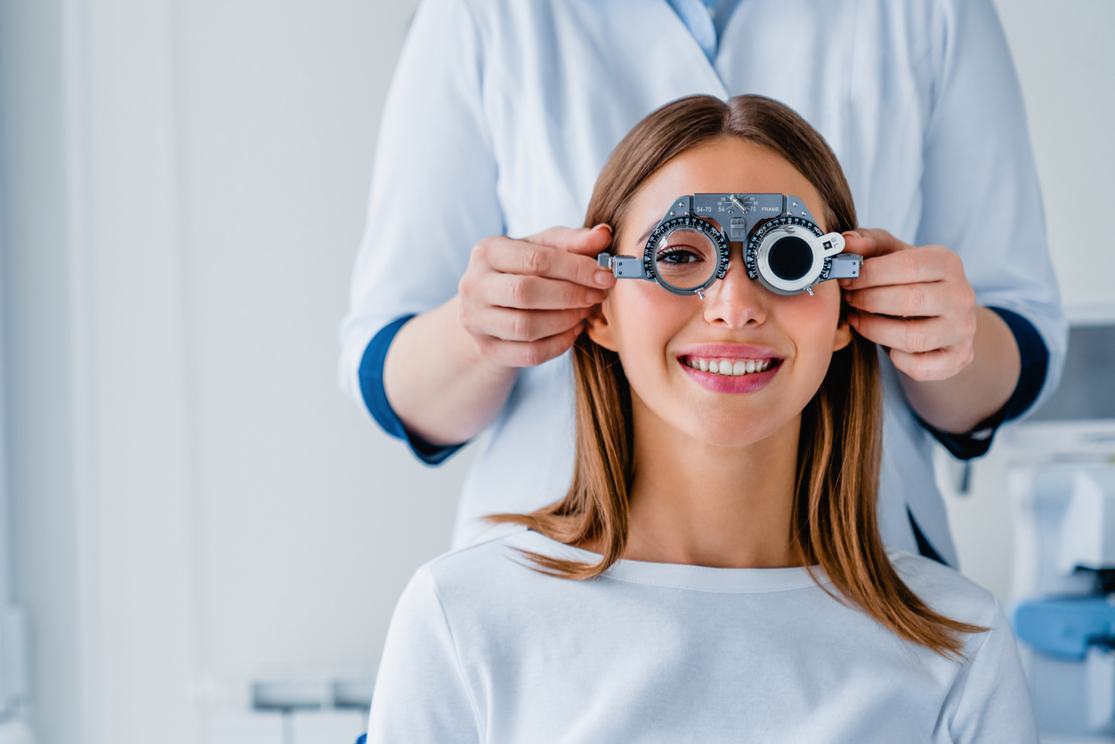 Female patient checking vision in ophthalmological clinic