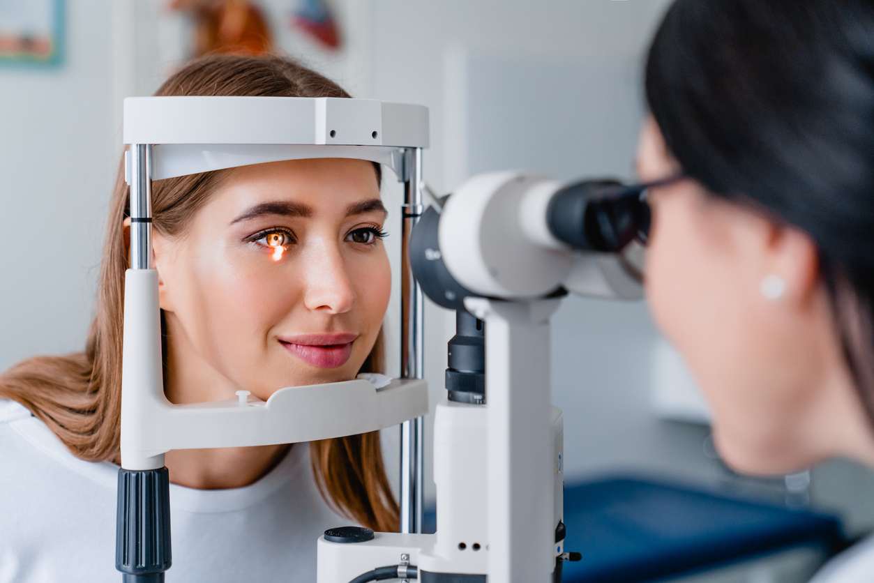 Eye doctor with female patient during an examination in modern clinic